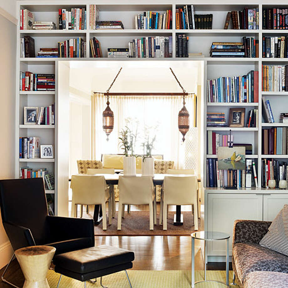 Frame a doorway Bookshelves surrounding the entry from a living room to a dining room make creative use of what might otherwise be under-utilized wall space. Read more: 24 inspiring small homes Photo: Thomas J. Story, Sunset.com