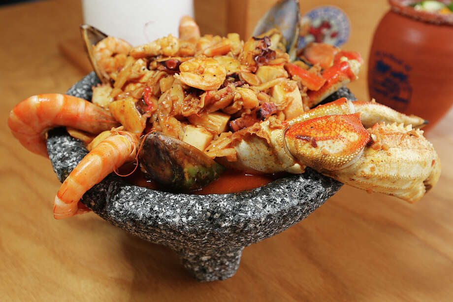 The Molcajete Cora at Las Islas Marias restaurant is a combination of shrimp, octopus, mussels, crab legs, fish, abalone and chopped clams. Photo: Jerry Lara /San Antonio Express-News / © 2015 San Antonio Express-News