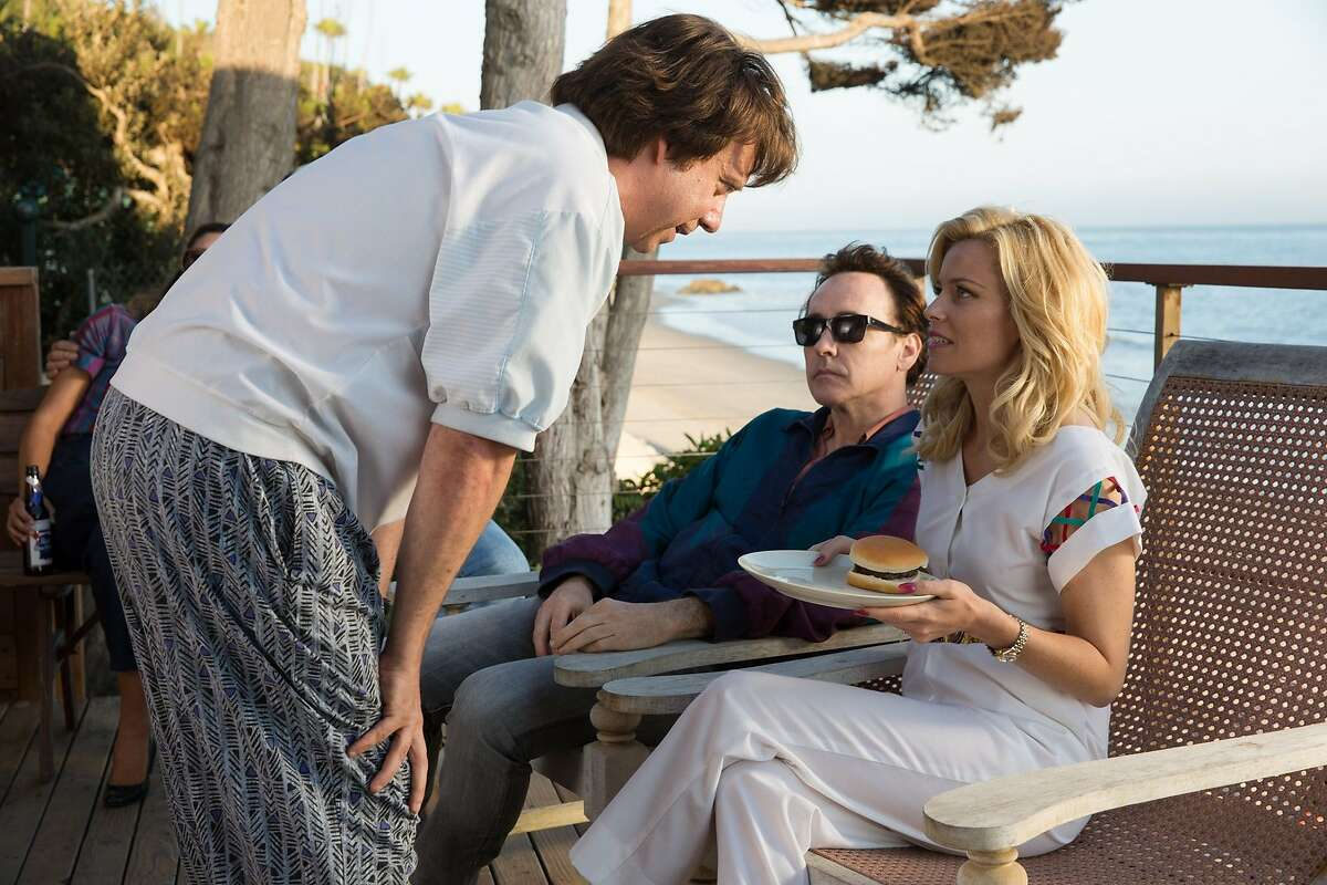 """Paul Giamatti as Dr. Eugene Landy, John Cusack as Brian Wilson and Elizabeth Banks as Melinda Ledbetter in """"Love & Mercy,"""" opening Friday, June 5, at Bay Area theaters. LM_04823.CR2"""