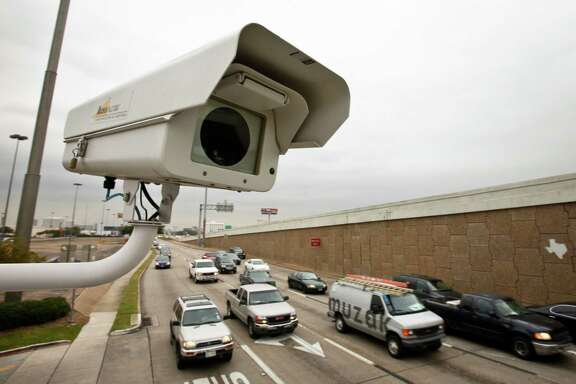 Rather than generating revenue, Tomball's red-light camera program has racked up a $1.9 million deficit in the collection of fines from violations. A red light camera perches above traffic at the intersection of Southwest Freeway and Bellaire Blvd. Monday, Nov. 15, 2010, in Houston.