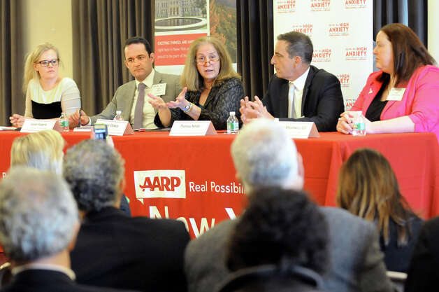 Diane Oakley, executive director of the National Institute of Retirement Security, center, speaks during an AARP sponsored panel discussion about retirement readiness on Wednesday, May 20, 2015, at the Albany Institute of History and Art in Albany, N.Y. Joining her, from left, are moderator Ashley Hupfl, Julian Federle, chief policy and programs officer; Thomas Nitido, deputy comptroller for New York State; and Sarah Mysiewicz Gill, senior legislative representative for AARP. (Cindy Schultz / Times Union) Photo: Cindy Schultz, Albany Times Union / 00031795A