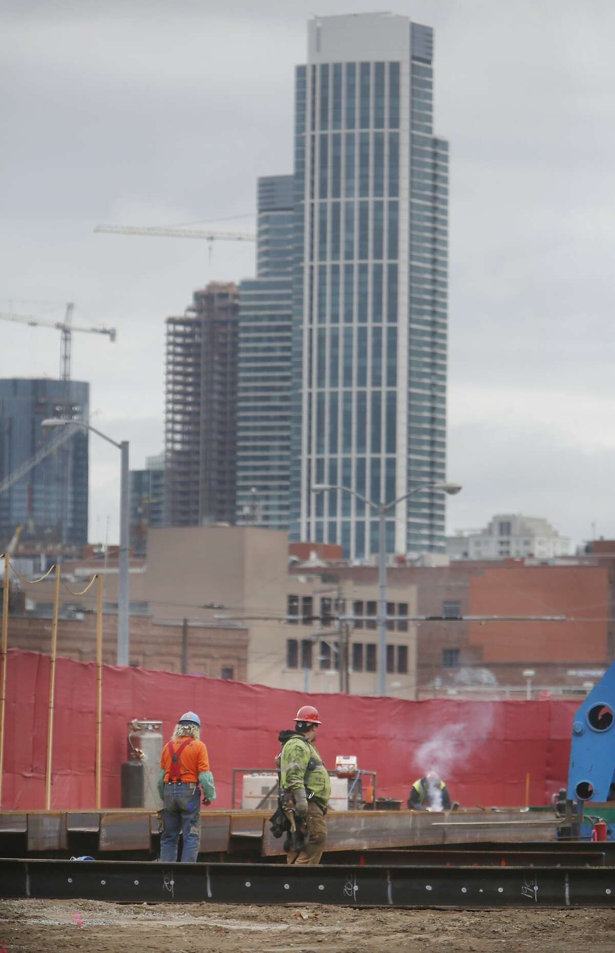 Suffolk Construction laborers work at the construction site at 360 Berry Street on Thursday, May 21, 2015 in San Francisco, Calif.