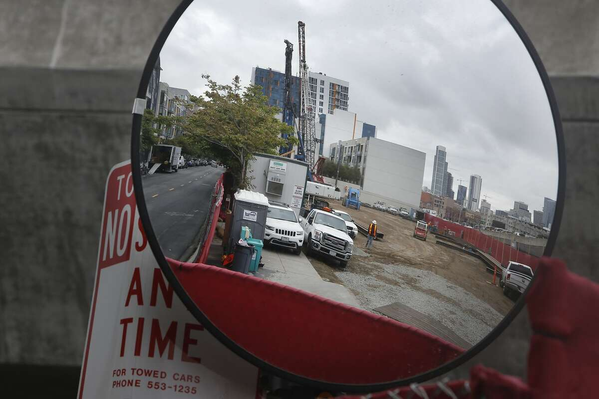 The construction site at 360 Berry Street is seen in a reflection in a mirror on Thursday, May 21, 2015 in San Francisco, Calif.