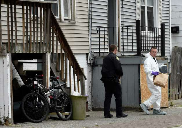 Albany Police investigate a murder in the 300 block of First Street Thursday morning May 21, 2015 in Albany, N.Y.    (Skip Dickstein/Times Union) Photo: SKIP DICKSTEIN