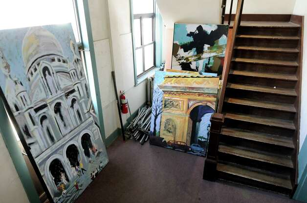 Scenery paintings line the stairway of the secondary building on Tuesday, Feb. 28, 2012, at Schenectady Light Opera Company in Schenectady, N.Y. (Cindy Schultz / Times Union) ORG XMIT: MER2015011309231564 Photo: Cindy Schultz / 00016565A