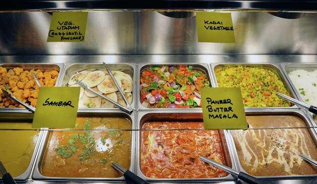 Food on the buffet at Spicy Mint Indian Cuisine on Tuesday, April 14, 2015 in Colonie, N.Y. (Lori Van Buren / Times Union) ORG XMIT: MER2015041511000940 Photo: Lori Van Buren / 00031421A