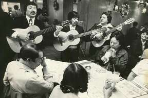 Trio Los Pepes plays for a table at Mi Tierra in this undated file photo.