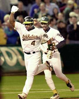 athletics299_db.jpg Oakland Athletics Miguel Tejada celebrates rounding third base after hitting a game winning walk off home run in the 10th inning vs. New York Yankees at Network Associates Coliseum. Coach Ron Washington in background.  8/1/03 in Oakland. DARRYL BUSH / The Chronicle