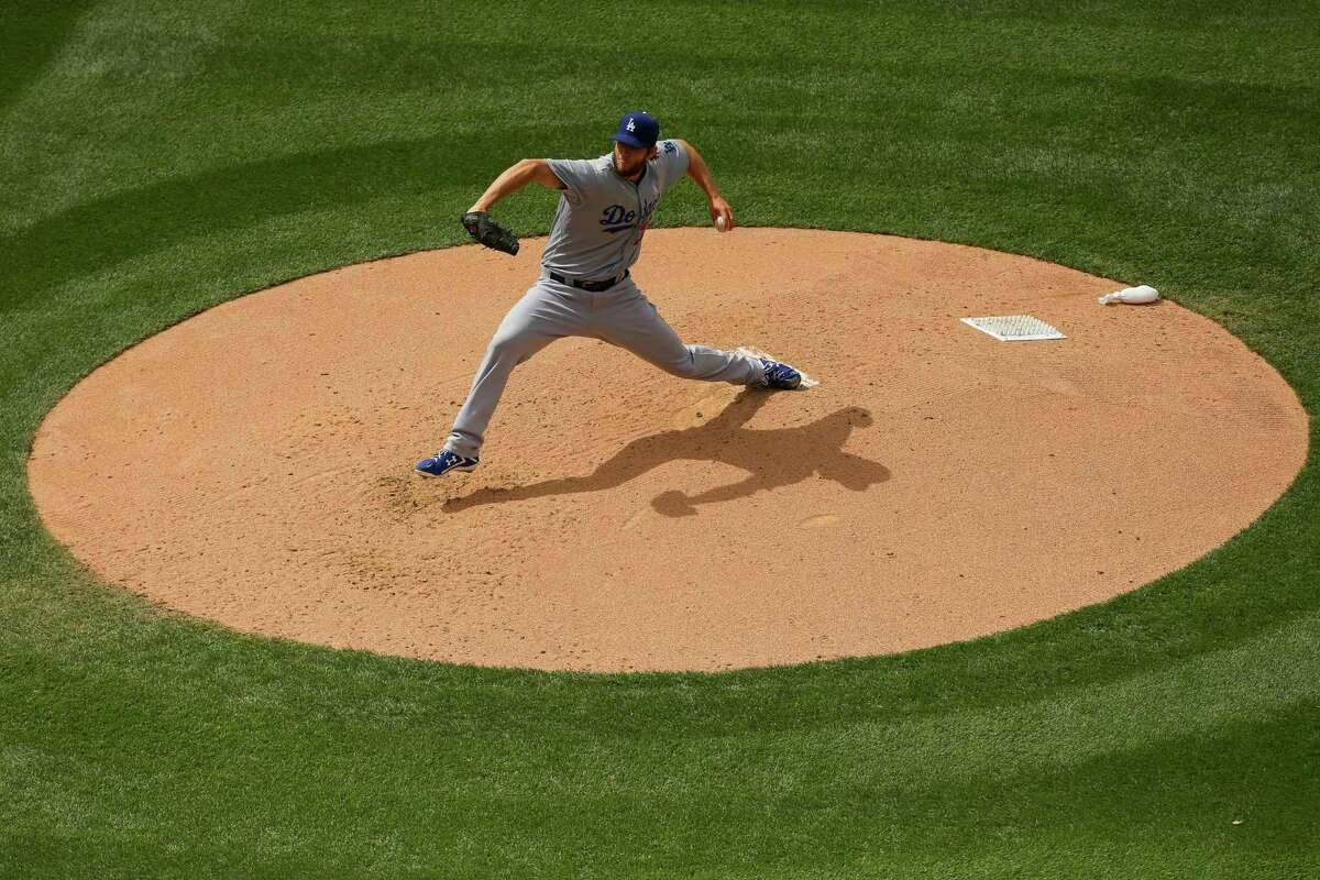 DENVER, CO - MAY 10: Starting pitcher Clayton Kershaw #22 of the Los Angeles Dodgers delivers to home plate during the fourth inning against Colorado Rockies at Coors Field on May 10, 2015 in Denver, Colorado. (Photo by Justin Edmonds/Getty Images)