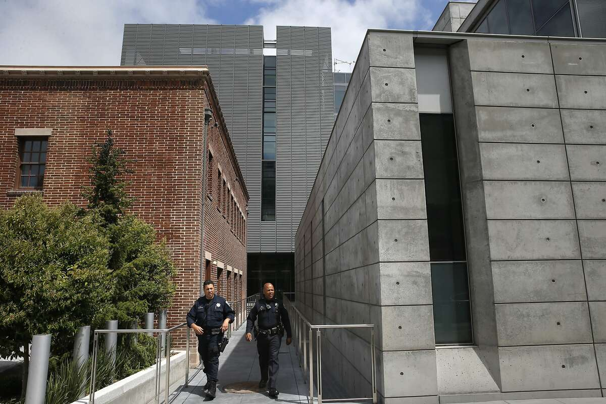 A view of police officers exiting the south main entrance of the newly completed Public Safety Building along 3rd St. which is home to the San Francisco Police Headquarters, a neighborhood Police Station and a restored neighborhood Fire Station, as seen on Thurs. May, 21, 2015, in San Francisco, Calif.