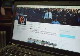 An illustration shows President Obama's Twitter page on a laptop in Washington.