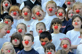 Massachusetts students show their support of Red Nose Day.