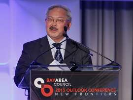San Francisco Mayor Ed Lee recognized the accomplishments of Governor Brown as he introduced him Thursday May 21, 2015. California Governor Jerry Brown was the first speaker at the Bay Area Council meeting discussing regional and statewide economic issues at the Ritz-Carlton hotel in San Francisco, Calif.