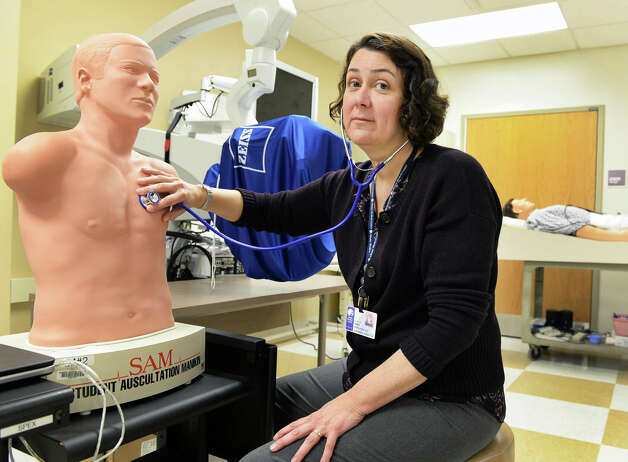 Director of the patient safety and clinical competency center Dr. Mara McErlean M.D. demonstrates SAM, a student auscultation manikin, in the task training room at Albany Medical College's Standardized Patient program Thursday March 19, 2015 in Albany, NY.  (John Carl D'Annibale / Times Union) Photo: John Carl D'Annibale / 518Life / 00031014A