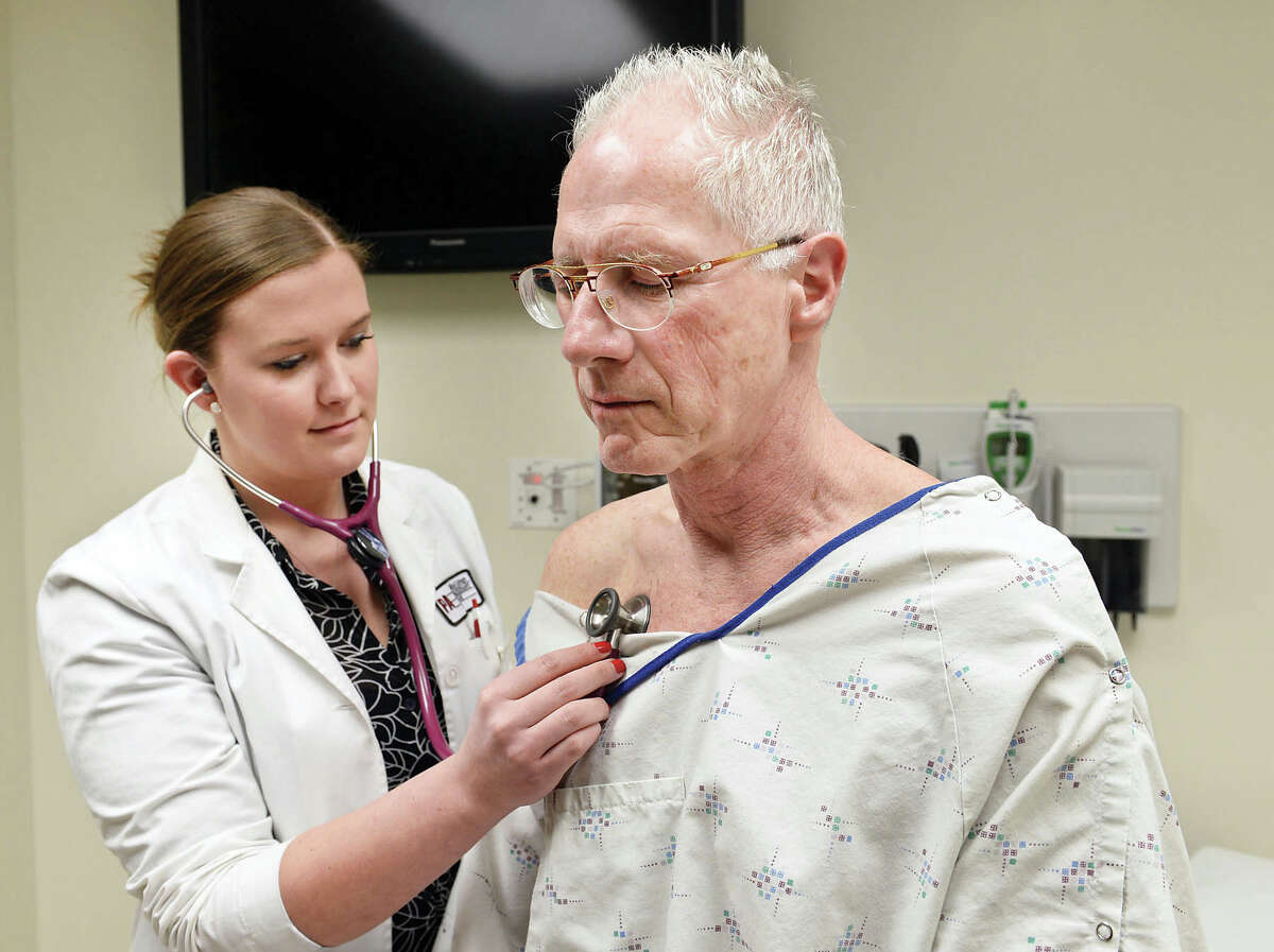 Physician assistant student Taylor Pettit, left, with standardized patient Tim Barr of Rotterdam during a patient exam as part of Albany Medical College's Standardized Patient program Thursday March 19, 2015 in Albany, NY. (John Carl D'Annibale / Times Union)