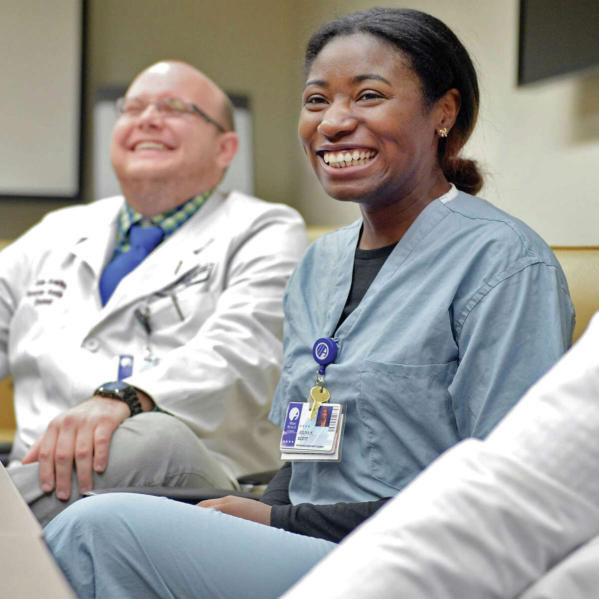 Physician assistant student Julina Scott, center, recounts experiences in the Albany Medical College's Standardized Patient program Thursday March 19, 2015 in Albany, NY. (John Carl D'Annibale / Times Union)