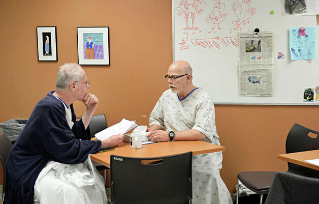 Standardized patients Tim Barr, left, of Rotterdam and Robert Gullie of Cohoes review case materials during a break in Albany Medical College's Standardized Patient program Thursday March 19, 2015 in Albany, NY.  (John Carl D'Annibale / Times Union) Photo: John Carl D'Annibale / 518Life / 00031014A