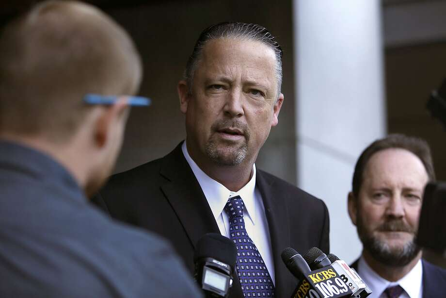 Former San Francisco police Sgt. Ian Furminger (middle) speaks to press in back of the Phillip Burton Federal Building & United States Courthouse in San Francisco, California on Monday, February 23, 2015. Furminger was found guilty of four felony charges. At right is his lawyer Brian Getz. Photo: Liz Hafalia, The Chronicle