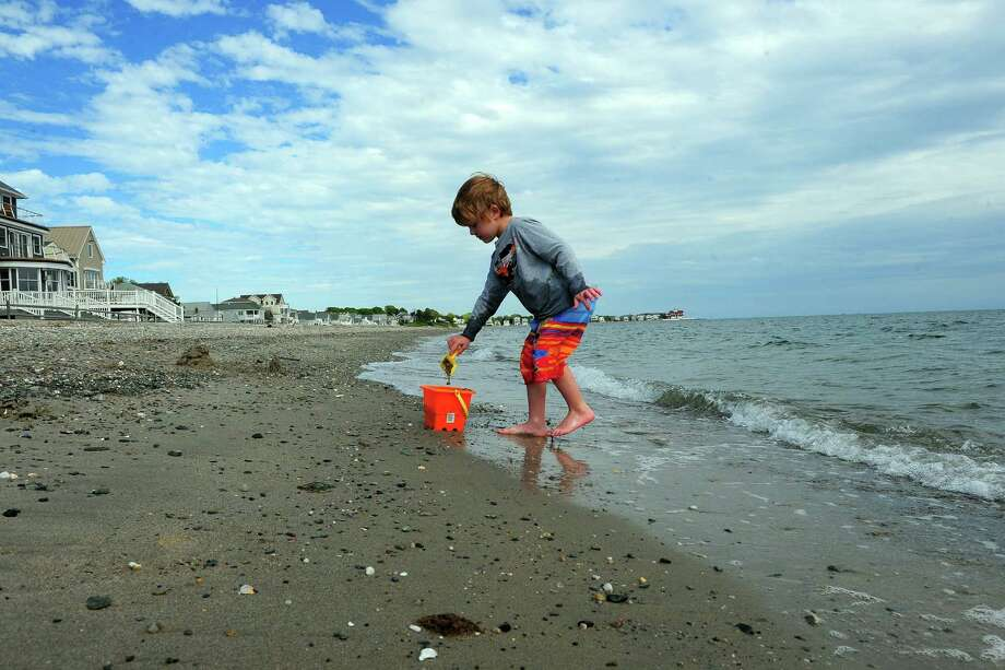 Micah Curington, 5, who is from Florida visiting family here, plays along the water's edge on Bayview Beach in Milford, Conn., on Thursday May 21, 2015. Photo: Christian Abraham / Connecticut Post