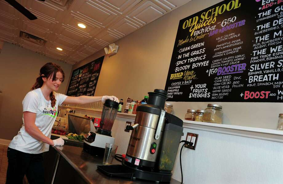 Nicole Gossett prepares a smoothie for a customer at The Healthy Hut, a new business on New Haven Avenue in Milford, Conn., on Thursday May 21, 2015. Connected to The Healthy Hut is The Plate, a restaurant serving breakfast and lunch. Photo: Christian Abraham / Connecticut Post