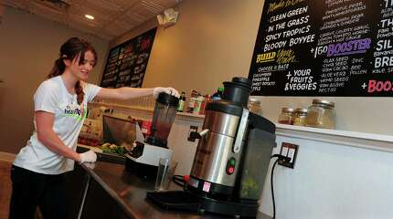 Nicole Gossett prepares a smoothie for a customer at The Healthy Hut, a new business on New Haven Avenue in Milford, Conn., on Thursday May 21, 2015. Connected to The Healthy Hut is The Plate, a restaurant serving breakfast and lunch.