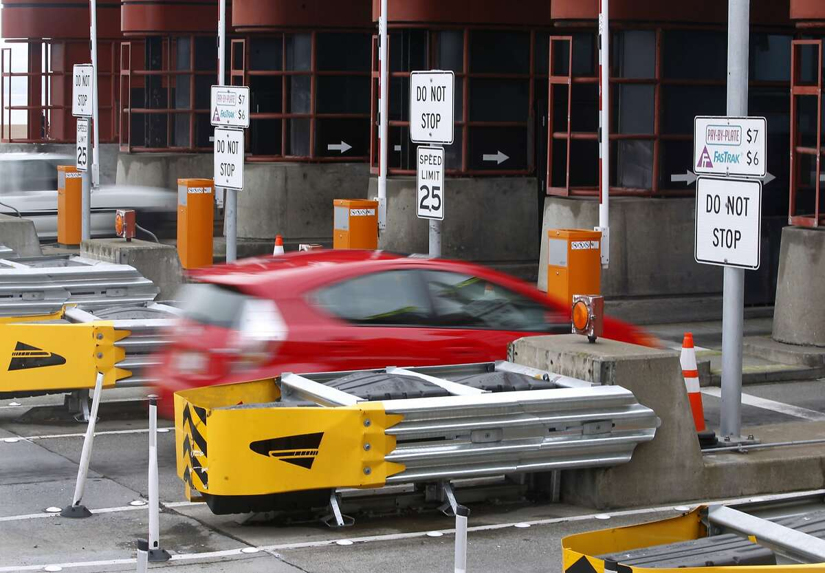 Commuters zip through the Golden Gate Bridge toll plaza in San Francisco, where the tolls are automatically collected.