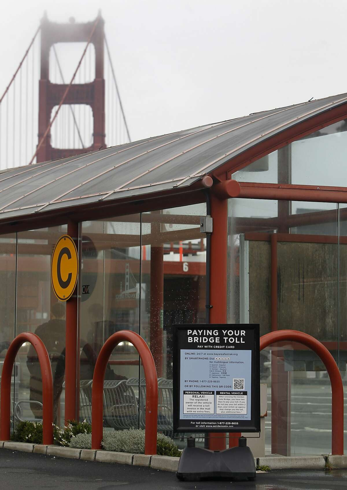 Signs inform out-of-towners how to pay bridge tolls at the Golden Gate Bridge toll plaza in San Francisco, Calif. on Thursday, May 21, 2015. Major rental car companies provide an option that allows customers to rent transponders for as much as $10 a day, but many tourists don't know that you can simply pay the $6 toll online, over the phone or at a gas station or convenience store in advance or within two days of crossing the span.
