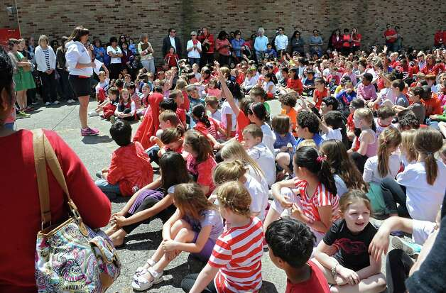 "Physical Education teacher Colleen Mickle talks to students before having them dance to ""Uptown Funk"" by Bruno Mars as part of Michelle Obama's Let's Move campaign to combat childhood obesity at Guilderland Elementary School Thursday, May 21, 2015 in Albany, N.Y. (Lori Van Buren / Times Union) Photo: Lori Van Buren / 00031943A"