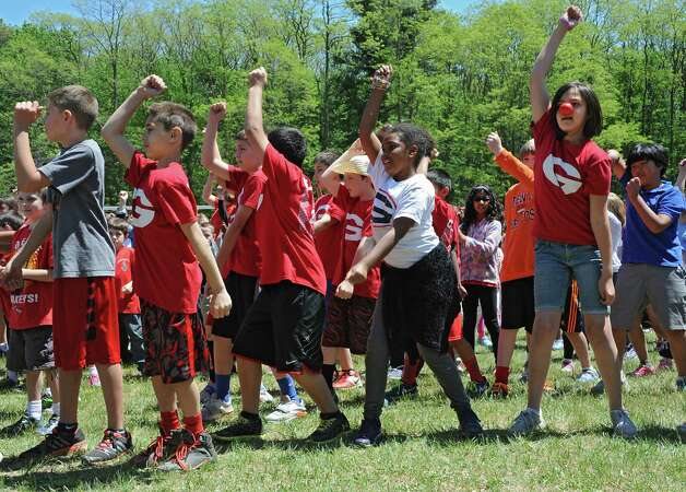 """More than 550 elementary school students dance to """"Uptown Funk"""" by Bruno Mars as part of Michelle Obama's Let's Move campaign to combat childhood obesity at Guilderland Elementary School Thursday, May 21, 2015 in Albany, N.Y. (Lori Van Buren / Times Union) Photo: Lori Van Buren / 00031943A"""