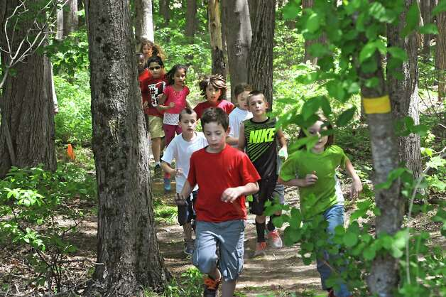 "More than 550 elementary school students participate in a fun run through the woods as part of Michelle Obama's Let's Move campaign to combat childhood obesity at Guilderland Elementary School Thursday, May 21, 2015 in Albany, N.Y. The children also danced to ""Uptown Funk"" by Bruno Mars. (Lori Van Buren / Times Union) Photo: Lori Van Buren / 00031943A"