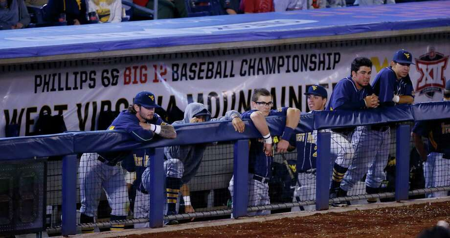 West Virginia players watch from the dugout in the ninth inning of a first-round game against Oklahoma State at the NCAA college Big 12 conference baseball tournament in Tulsa, Okla., Wednesday, May 20, 2015. Oklahoma State won 3-0. Photo: Sue Ogrocki /Associated Press / AP