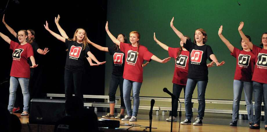 Region Girls Choir members perform during the McCullough Junior High choir's pop concert at the Nancy Bock Center of the Performing Arts auditorium. Photograph by David Hopper. Photo: David Hopper, Freelance / freelance