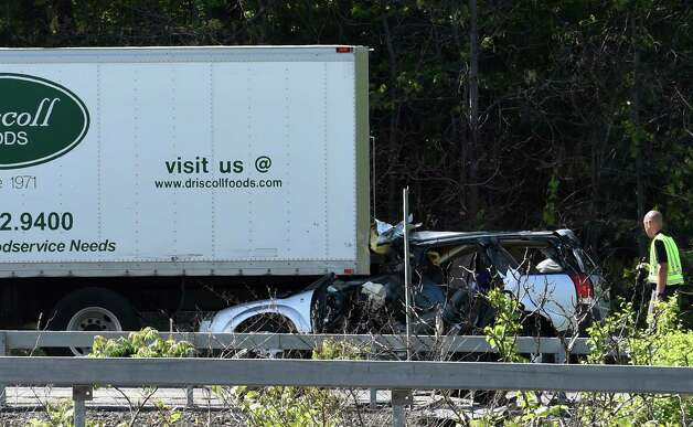 An accident investigator from the New York State Police works the scene of a fatal crash Thursday afternoon, May 21, 2015, on I- 87 in the southbound lane just north of Exit 5 in Colonie, N.Y,   (Skip Dickstein/Times Union) Photo: SKIP DICKSTEIN