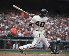 The San Francisco Giants' Madison Bumgarner hits a solo home run in the third inning against the Los Angeles Dodgers' Clayton Kershaw on Wednesday, May 21, 2015, at AT&T Park in San Francisco. (Jose Luis Villegas/Sacramento Bee/TNS)