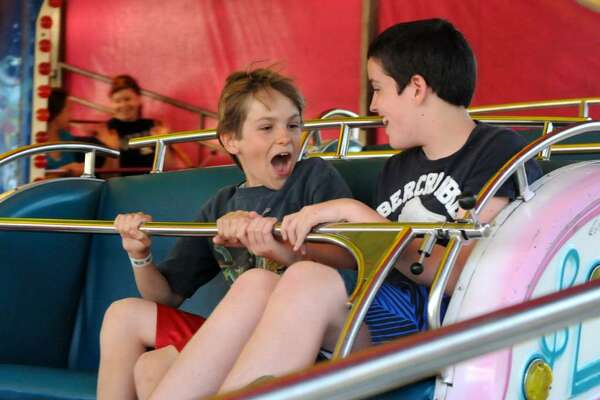 Ciaran Conway, 12, left, and Owen Benfield, 12, both of Brewster, ride the Music Express at the Danbury City Fair on Thurs. July 1, 2010.