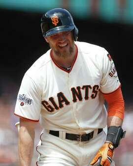 San Francisco Giants' Hunter Pence reacts after striking out on a pitch from Los Angeles Dodgers' Clayton Kershaw during the sixth inning of a baseball game, Thursday, May 21, 2015, in San Francisco. (AP Photo/Beck Diefenbach)