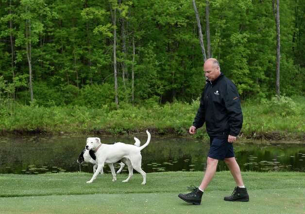 Joe Lucas, vice president, of greens and grounds at Saratoga National Golf Course walks the course, inspecting the grounds Wednesday morning May 20, 2015 in Saratoga Springs, N.Y.      (Skip Dickstein/Times Union) Photo: SKIP DICKSTEIN / 00031907A