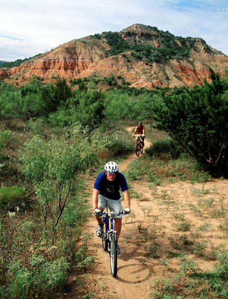 Palo Duro Canyon mountain bikers follow a path along the Panhandle Plains Wildlife Trail.