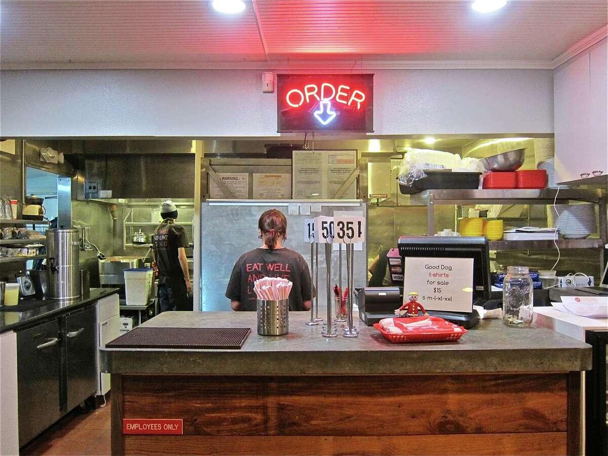 Customers order food at the counter at Good Dog Houston.