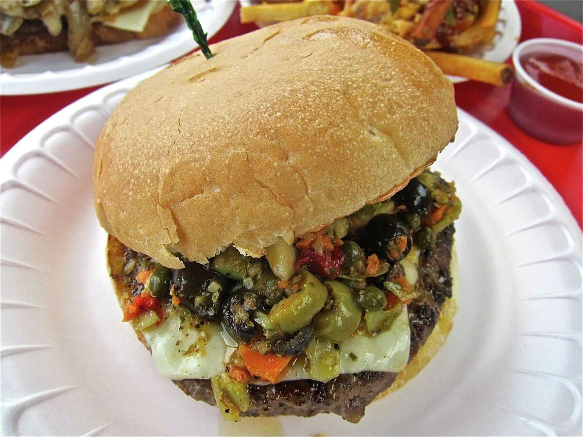 The Muffuletta Burger with Swiss and olive salad at the Hubcap Grill in Kemah.