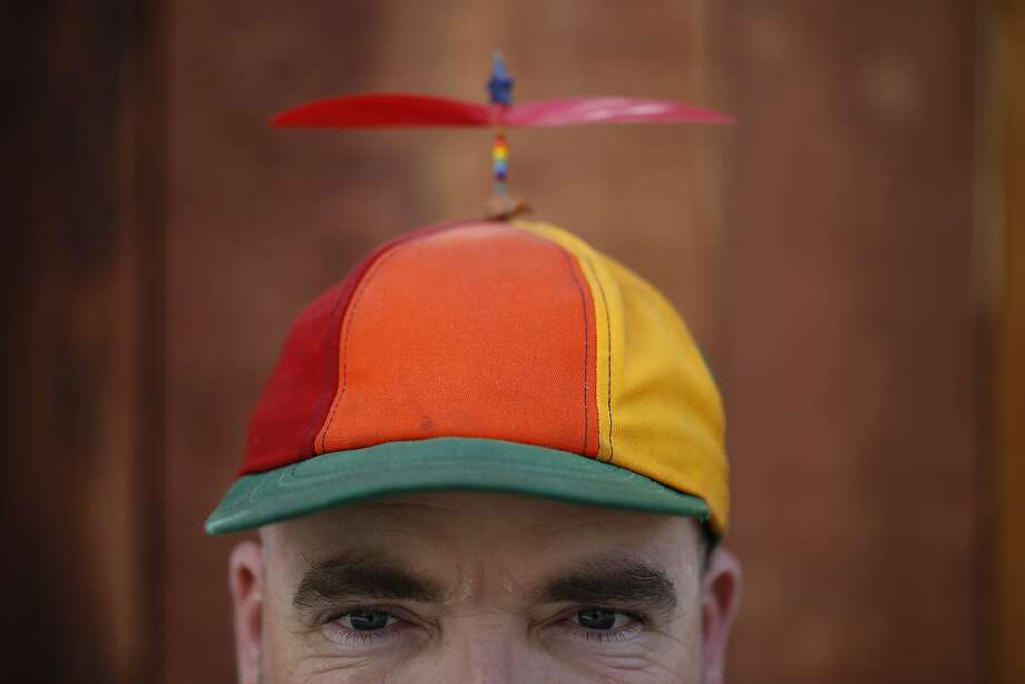 Known for his whirly gig hat, chalk artist Nikolas Larson takes a break from his art on Friday May 18, 2015 in San Francisco, Calif. Photo: Mike Kepka, The Chronicle