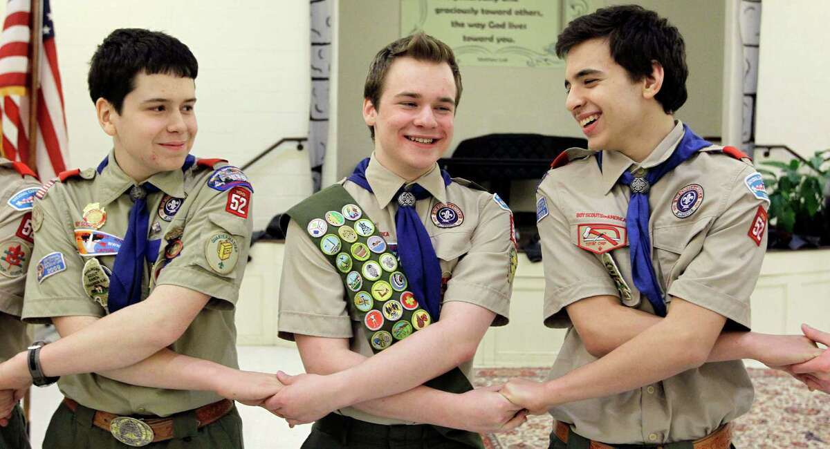 Pascal Tessier, center, seen earlier this year with fellow Scouts after he received his Eagle Scout badge in Chevy Chase, Md., is openly gay. The Boy Scouts' New York chapter in April announced it had hired Tessier as a summer camp leader.