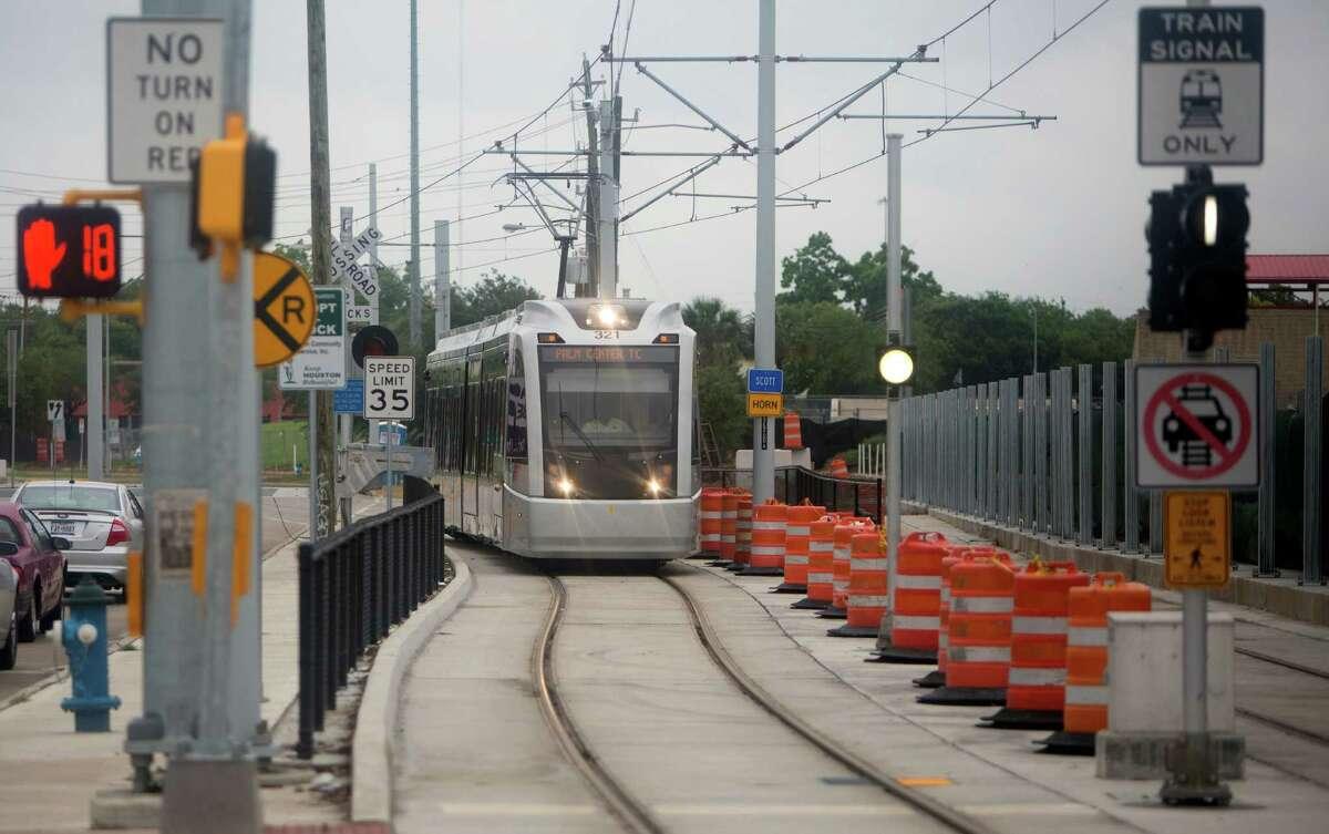 The METRO rail is seen along Scott Street near the University of Houston, Wednesday, May 13, 2015, in Houston. (Cody Duty / Houston Chronicle)