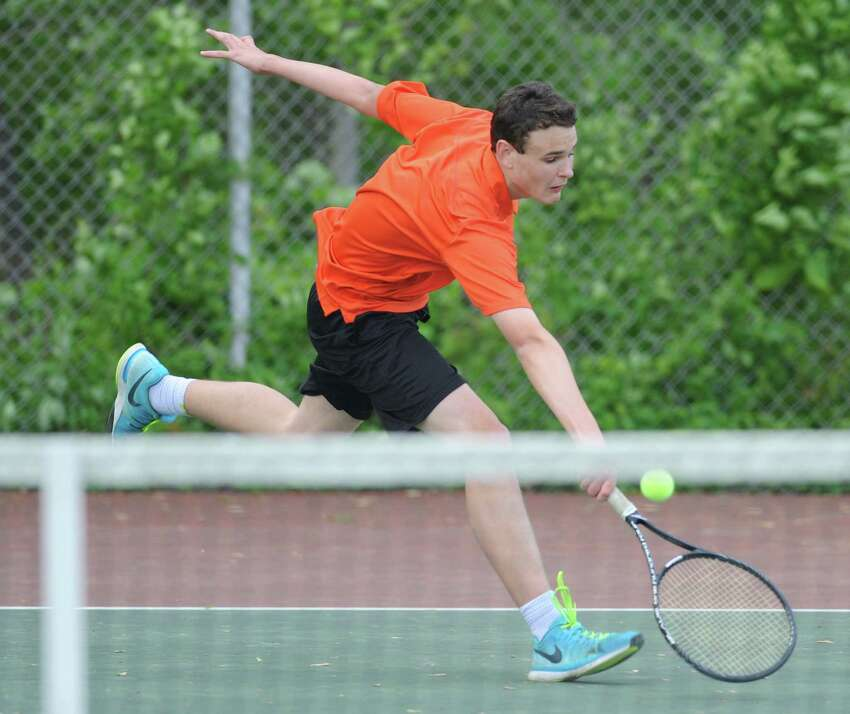 Ridgefield's Will Hogan volleys in his match against Greenwich's Henry Lewis in the high school boys tennis match between Greenwich and Ridgefield at Greenwich High School in Greenwich, Conn. Thursday, May 21, 2015.