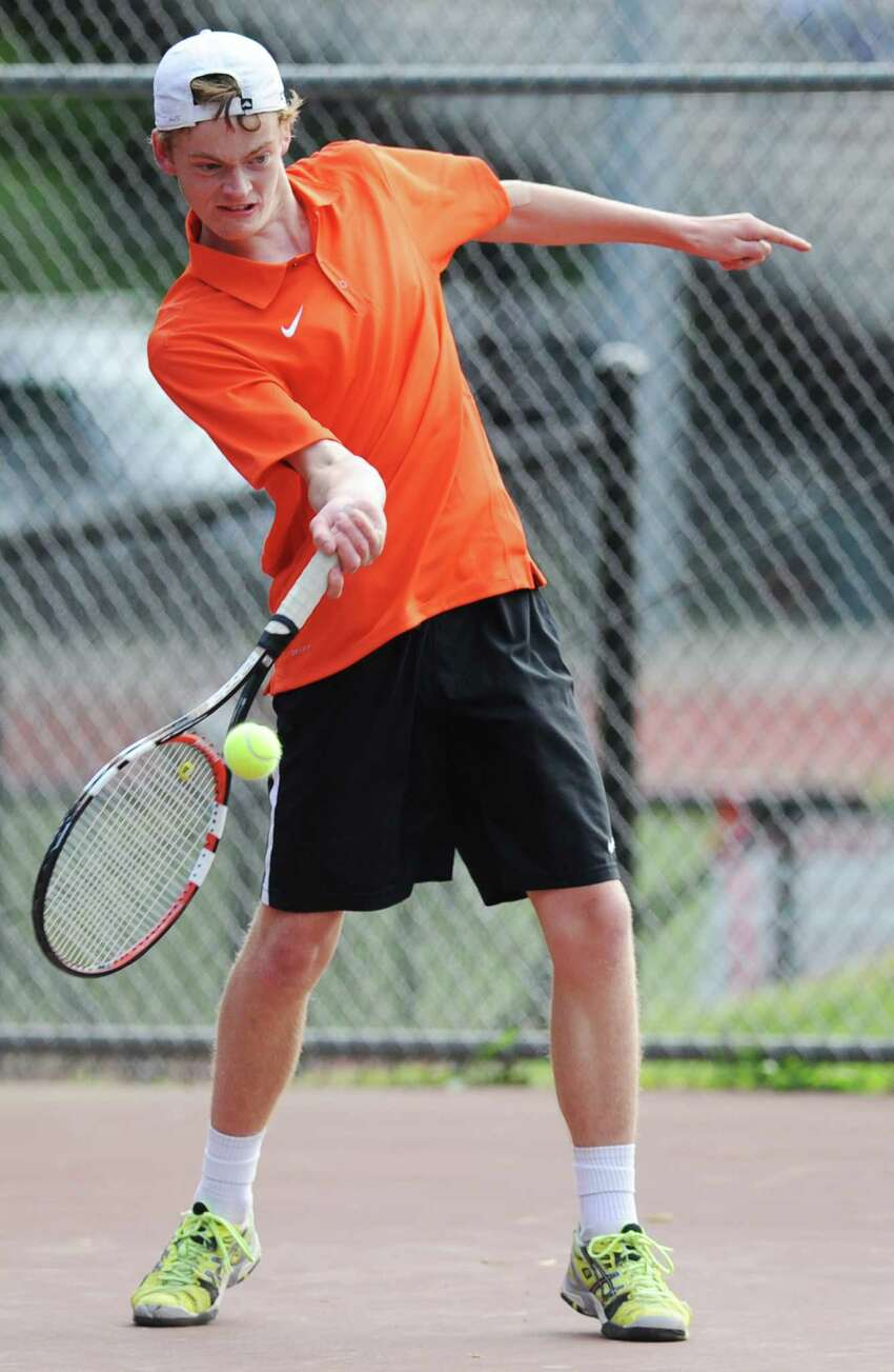 Ridgefield's Owen Isley volleys in his match against Greenwich's Skylar Wasserman in the high school boys tennis match between Greenwich and Ridgefield at Greenwich High School in Greenwich, Conn. Thursday, May 21, 2015.