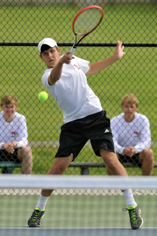 New Canaan's Alexander Merjian returns the ball during his singles match against Fairfield Warde's Jack Johnson at New Canaan High School in New Canaan, Conn., on Thursday, May 21, 2015. New Canaan won the FCIAC playoff quarterfinal, 5-0. Photo: Jason Rearick / Stamford Advocate