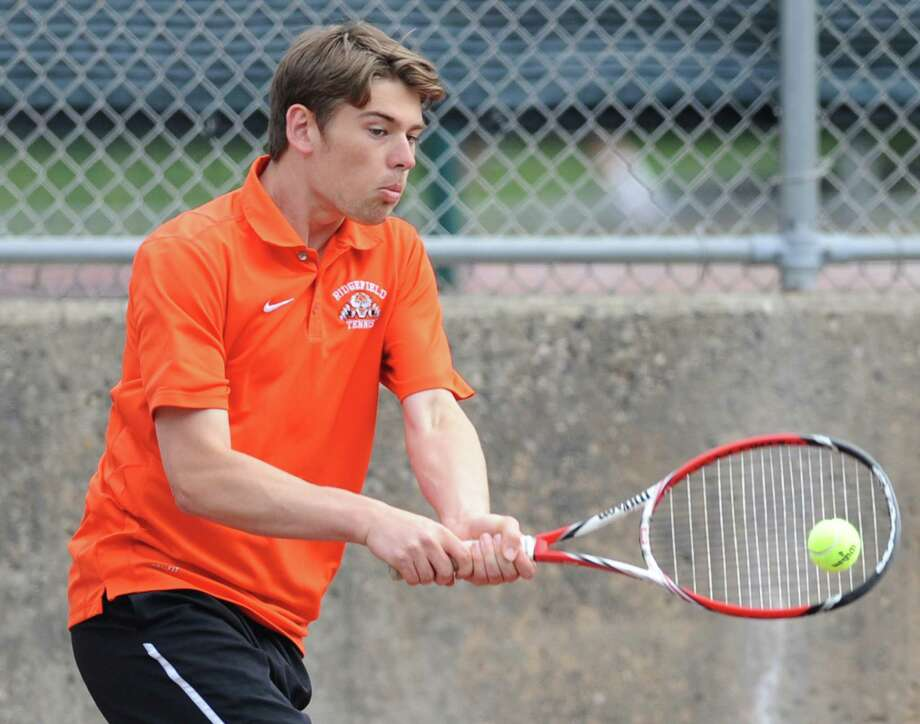 Ridgefield's Pat Delany volleys in his match against Greenwich's Marcos Eslava in the high school boys tennis match between Greenwich and Ridgefield at Greenwich High School in Greenwich, Conn. Thursday, May 21, 2015. Photo: Tyler Sizemore / Greenwich Time