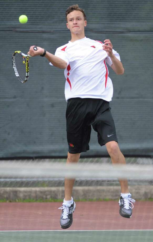 Greenwich's Henry DeCoster volleys in his match against Ridgefield's Tal Nizan in the high school boys tennis match between Greenwich and Ridgefield at Greenwich High School in Greenwich, Conn. Thursday, May 21, 2015. Photo: Tyler Sizemore / Greenwich Time