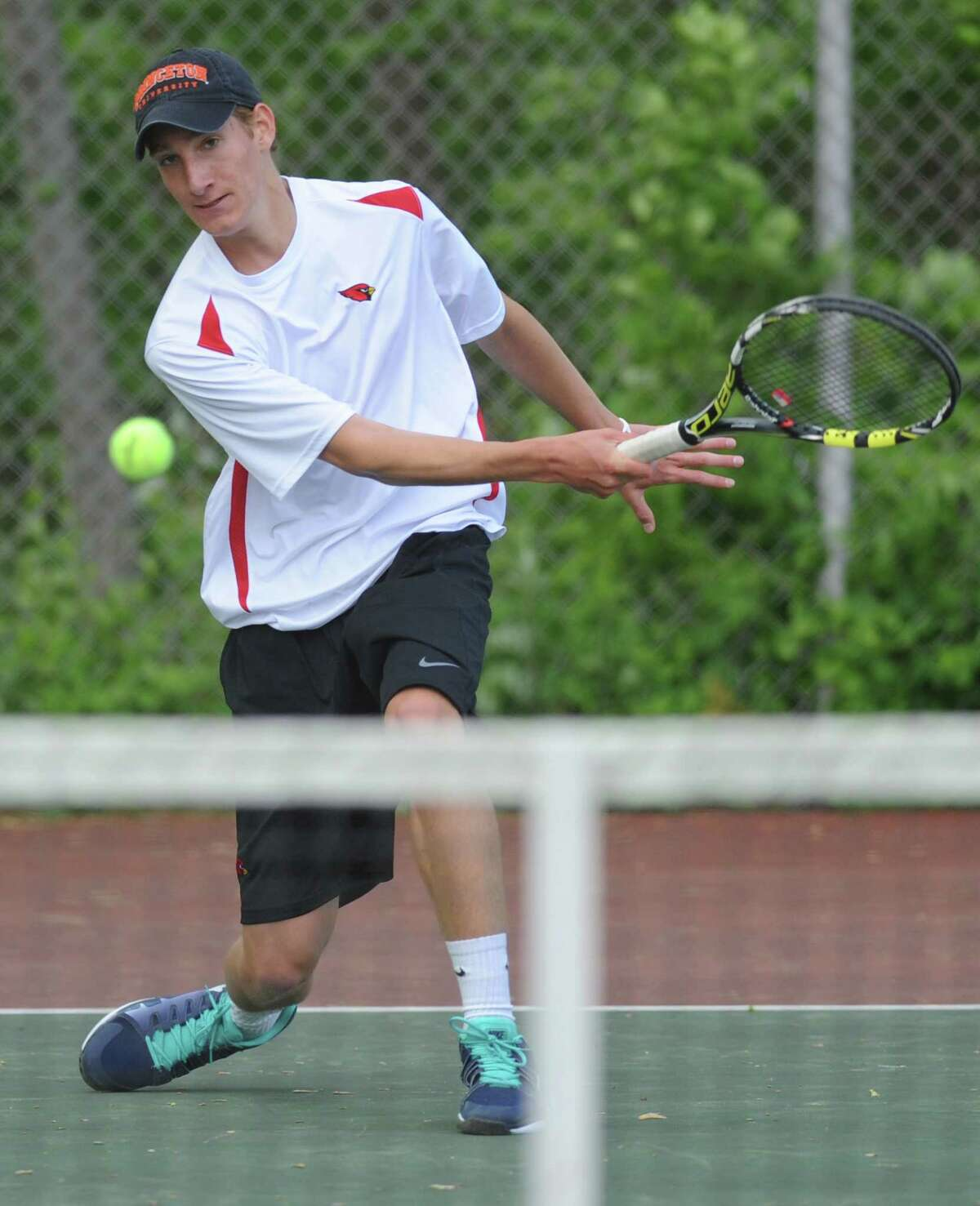 Greenwich's Henry Lewis volleys in his match against Ridgefield's Will Hogan in the high school boys tennis match between Greenwich and Ridgefield at Greenwich High School in Greenwich, Conn. Thursday, May 21, 2015.