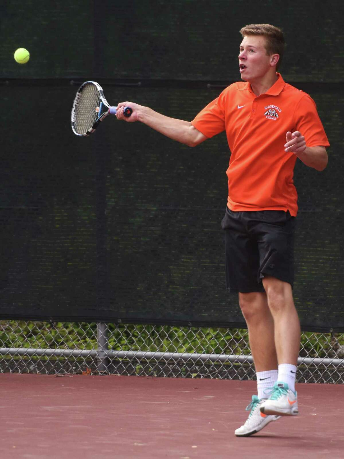 Photos from the high school boys tennis match between Greenwich and Ridgefield at Greenwich High School in Greenwich, Conn. Thursday, May 21, 2015.